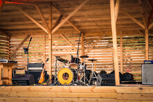 An Open-air Music Stage With Musical Instruments And Sound Equipment.
