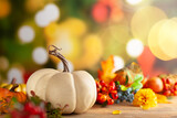 Fototapeta Kawa jest smaczna - Autumn floral still life with pumpkins,berries and flowers on the table. Autumnal festive concept.