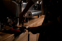 Female Barista Hands Holding Portafilter And Coffee Tamper Making An Espresso Coffee.