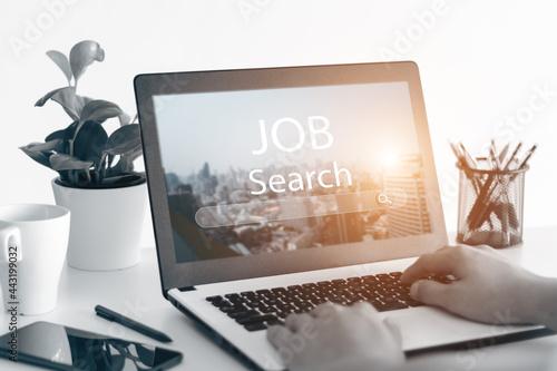 Fototapeta The idea of a dream job where you need, job finding app on a laptop