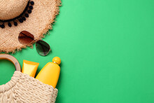 Flat Lay Composition With Stylish Straw Hat And Beach Accessories On Green Background, Space For Text