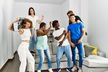 Group Of Young Friends Smiling Happy And Dancing At Home.