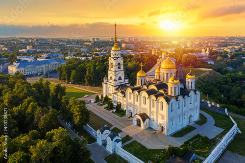Aerial drone view of Assumption Cathedral in the city center of Vladimir with Klyazma river with summer sunny day sunset