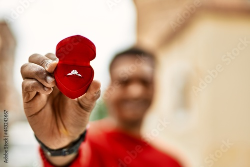Fotografija Handsome african american young man holding engagement ring