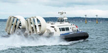 Southsea, England, UK, July 2021. A Passenger Carrying Hovercraft Underway Over Water With The Fans Visible On The Stern.