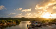 Fisherman Boat With Sunset Sky In Fishing Village, Ban Pak Nam Khaem Nu, Chanthaburi, Thailand.