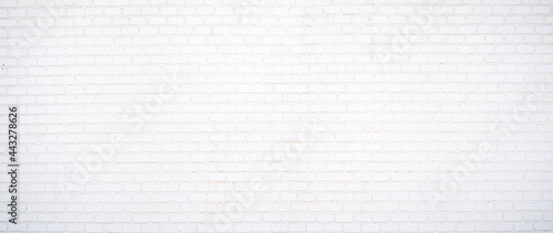 Foto white brick wall may used as background
