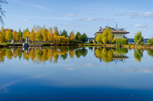 Lake House With Trees, Autumn, Clear Day. High Quality Photo