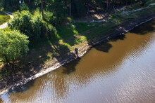 Top View, A Fisherman Fishing By The River. Beautiful Landscape Of Rivers And Forests