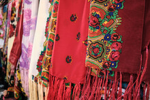 Colorful Traditional Middle Eastern Shawls Hanging At Bazaar. Multi-colored Headscarfs