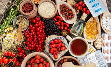 Medicinal Plants And Herbs Composition - Rosehips, Oil, Herbal Tea, Goji Berries And Chamomile