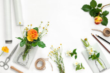 Set Of Wrapping Paper And Flowers For Handmade On On White Background. Homemade Craft Box Gifts With Painted Vase, Bouquet Of Yellow Roses And Delicate Daisies.