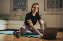 Young Attractive Woman Posting Her Training Routine From Home