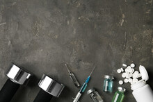 Different Drugs, Sports Equipment And Space For Text On Grey Table, Flat Lay. Doping Control