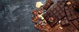 Fototapeta Kawa jest smaczna - Cacao beans and chocolate on gray background.