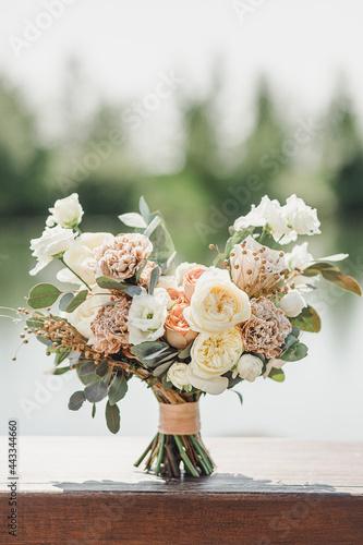 Fototapeta Bridal bouquet of white beige free-form flowers
