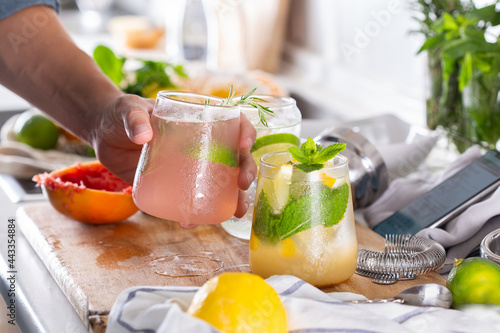 Fotografiet Mixologist making refreshing cocktails with hard seltzer at home