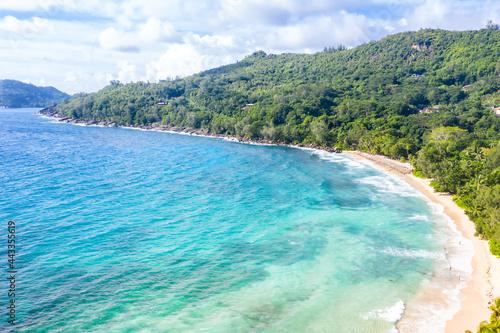 Fotografiet Seychelles Takamaka beach Mahe island vacation sea ocean palms drone view aerial