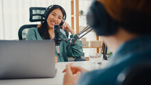 Asia Girl Radio Host Record Podcast Use Microphone Wear Headphone Interview Celebrity Guest Content Conversation Talk And Listen In Her Room. Audio Podcast From Home, Sound Equipment Concept.