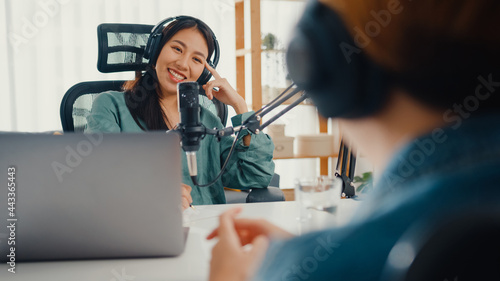 Fotografija Asia girl radio host record podcast use microphone wear headphone interview celebrity guest content conversation talk and listen in her room