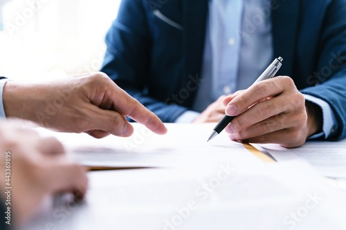 Lawyer Legal counsel presents to the client a signed contract with gavel and legal law Fototapeta