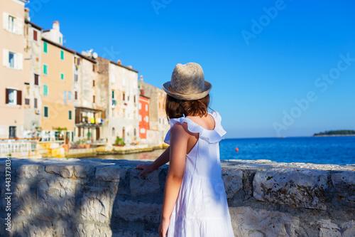 Fotografija Little cute girl  posing on the embankment of Rovinj town, Croatia