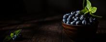 Freshly Picked Blueberries In Wooden Bowl