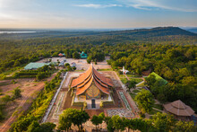 Top View Aerial Photo From Flying Drone.Amazing Sirindhorn Wararam Phu Prao Temple (Wat Phu Prao), Sirindhorn - Tree Shaped Fluorescence Art Temple In Thailand.Photo By Select Focus.