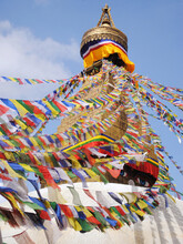 Colorful Prayer Flags Flutter At Boudhanath In Kathmandu, Nepal. This Is The Holiest Buddhist Pilgrimage Places For Buddhists All Over The World And It Was Built By Licchavi King In 5th Century A.D.