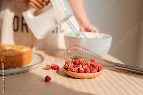 Obraz na plátně Kitchen mixer whips cream to make sponge cake or red velvet cake.