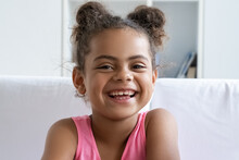 Closeup Portrait Of Happy Smiling African American Girl Child Looking At Camera