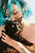 Naked Woman Embracing Cat On Sunny Day