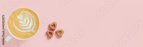 Carta da parati Web banner with delicious cappuccino and three pieces of sugar in the shape of hearts on pink background