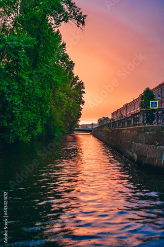 The embankment of St. Petersburg during a bright sunset. Fototapeta