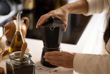 Woman Making Coffee In An Italian Coffee Maker