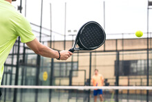 Back View Of A Man Playing Paddle Tennis