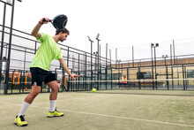 Young Man Serving In A Paddle Tennis Game