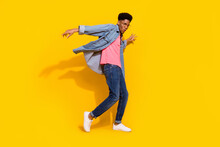 Full Body Photo Of Happy Cheerful Dark Skin Man Fly Wind Shirt Dancer Isolated On Bright Yellow Color Background