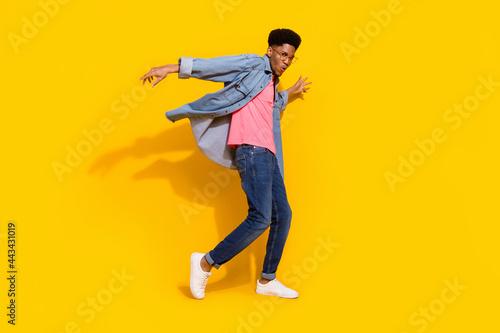 Leinwand Poster Full body photo of happy cheerful dark skin man fly wind shirt dancer isolated o