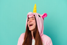 Young Caucasian Woman Wearing A Unicorn Pajama Isolated On Blue Background