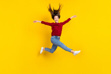 Full Length Body Size View Of Pretty Funky Cheerful Carefree Girl Jumping Having Fun Isolated Over Bright Yellow Color Background