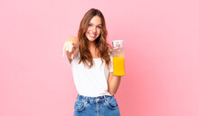 Young Pretty Woman Holding An Orange Juice
