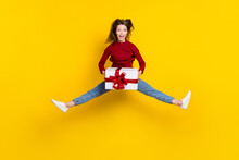 Full Length Body Size View Of Pretty Cheerful Girl Jumping Holding Giftbox Having Fun Isolated Over Bright Yellow Color Background