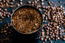 Coarsely Ground Coffee Beans In A Grinder: Coffee Grounds In An Electric Coffee Grinder