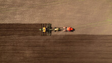 Agriculture Tractor Cultivation And Plows Land Of Field For Planting Cereals Plough, Aerial Top View Rural