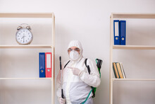 Old Male Contractor In Office Disinfection Concept
