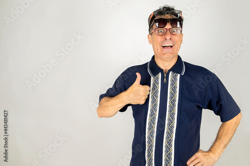 Fotografie, Obraz Goofy guy with two pair of glasses on face with a thumb up expression celebrating vacation time