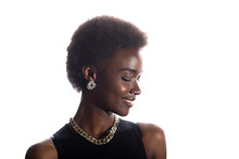 Close Up Portrait Of Smiling Black African American Woman With Afro Hairstyle On White Studio Background.