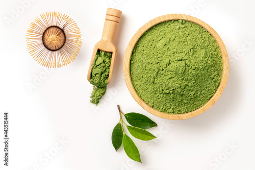 Fotografie, Obraz Matcha green tea powder in wooden bowl with japan wire whisk , scoop , and leaves isolated