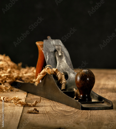 Fotografie, Obraz Jack plane on carpenter's table with chips scattered around